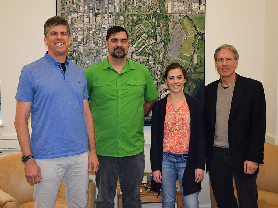 A Picture of Associate Professor Stephen Muench, Undergraduate Casey Hoyt, Undergraduate Liz Guilford and Chair Greg Miller, from left to right.