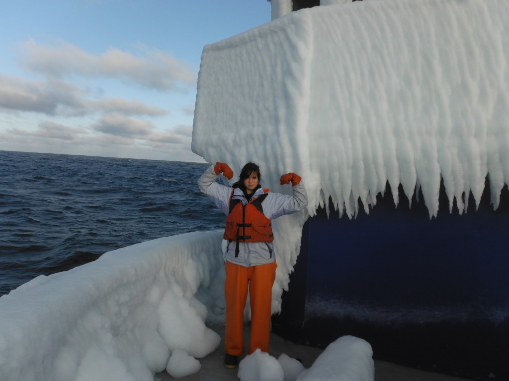 Lindsey, on the bow  of a fishing boat covered in ice in Alaska