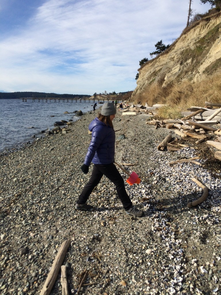Service learning student Christie paces the width of the beach.