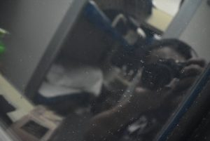 A photo An took of her reflection through the window on a train to Beijing.