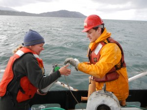 Andrea and Trevor prepare to collect a surface water sample with a Niskin bottle.