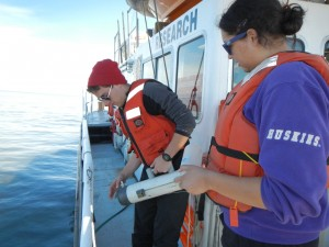 Ben and Tianna collect water samples.