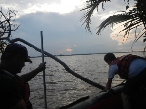 Chuck and Dan deploy a turbidity sensor at sunset in the Mekong
